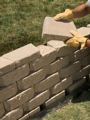 Garden Block Wall Ideas building a concrete block retaining wall building masonry walls patios walkways Put On Caps Enlarge Image
