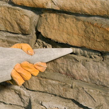 how to build a rock retaining wall with mortar