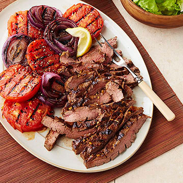 ... -Mustard Marinated Flank Steak with Grilled Tomatoes and Onions