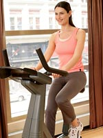 woman sitting properly on exercise bike