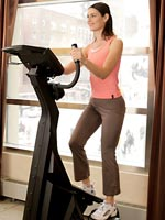 woman standing upright on stair master