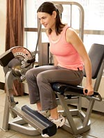 woman doing leg extensions leaning forward