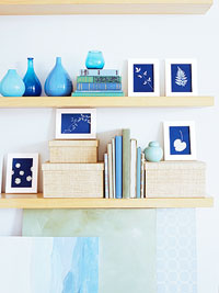 boxes and picture frames on shelves