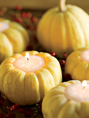 Miniature pumpkins as candle holders