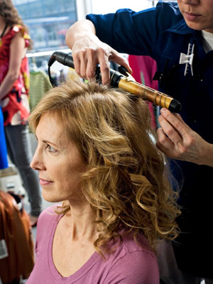 Mother with curling iron in hair