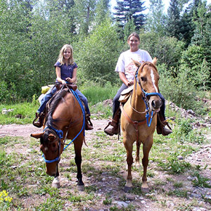 two people on horseback