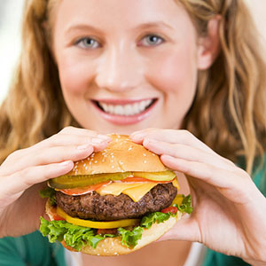 teenager eating burger