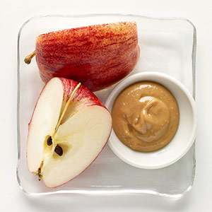 Apple and peanut butter in dish