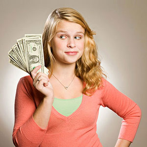 Teenage girl with dollar bills
