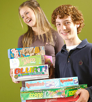 kids holding  board games