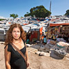 Danielle Butin of AFYA in front of tents