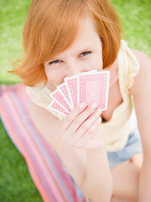 Woman holding cards