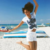 Girl jumping on beach with energy