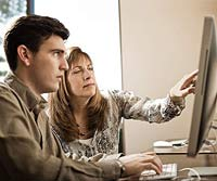 Mom and autistic son on computer