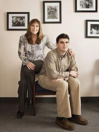 Mom and son by hanging picture frames