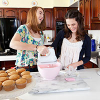 Leanne Youstra and Margaret Quinn making cupcakes