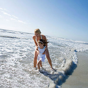 Mom and daughter on beach