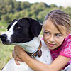 Girl hugging dog