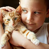 Child holding cat