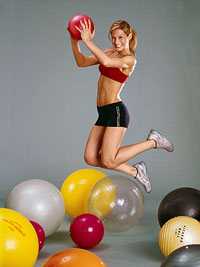 Girl Jumping with Exercise Ball