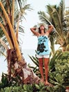 Woman Standing On Palm Tree