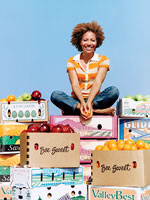 Girl sitting on boxes of fruit