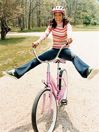 Woman riding pink bike with pink helmet