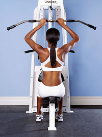 woman using lat pull-down
