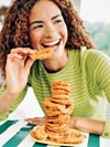 woman eating onion rings