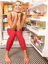 girl sitting in refrigerator