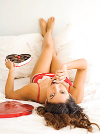 girl in bed eating chocolates