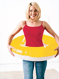 Woman with inner tube around waist
