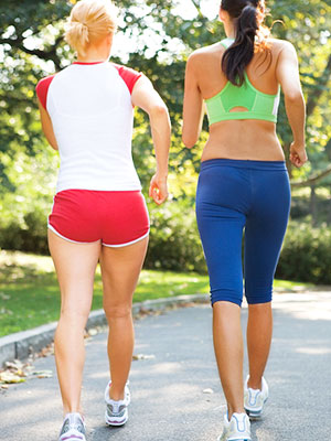 Rear view of two women walking