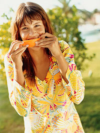 woman eating orange slice
