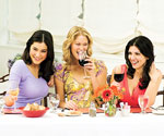 3 woman drinking wine at dinner table