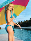 woman in bikini holding oversize umbrella