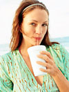 woman sipping drink through straw