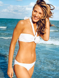 woman on beach in bikini smiling
