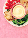 plate of veggies and crackers and dip