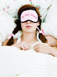 sleeping girl with eye mask