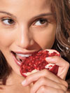 Woman eating a pomegranate