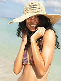 woman wearing hat on the beach