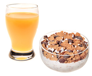 Iron-Fortified Cereal and Glass of Orange Juice