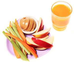 celery, carrots, apples, peanut butter and orange juice