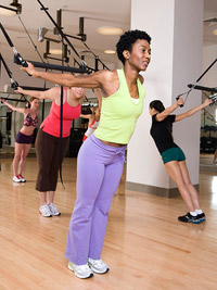 women using exercise machines at the gym