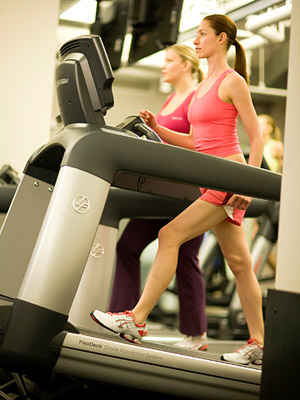 women walking on treadmills in the gym