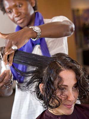 Salon owner Edris Nicholls adds layers to Lisa's hair