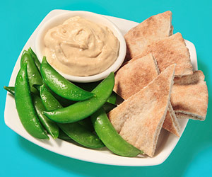 hummus with pita and pea pods