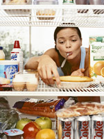 woman eating from the fridge
