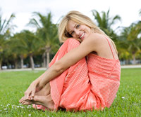 Blonde sitting on grass